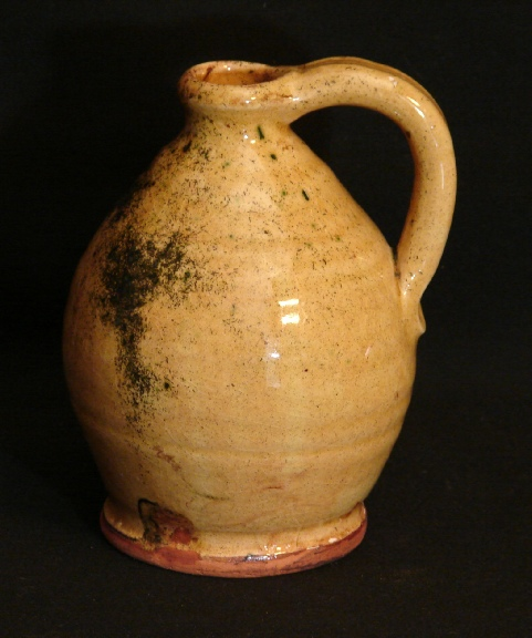 redware watkins jug, spangles on gold